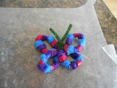 Pipe cleaner and paper scraps turn into butterfly