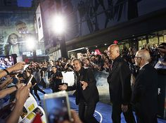 George Clooney faced a horde of fans for the Chinese premiere of Tomorrowland in Shanghai May 22.