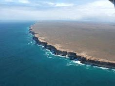 """Often described as """"The End of the World"""", the Bunda Cliffs run more than along the Great Australian Bight, and are the longest uninterrupted line of sea cliffs on Earth. They fall dramatically into the Southern Ocean from the Nullabor Plain. Ends Of The Earth, End Of The World, Australia Travel, Western Australia, Australia Funny, South Australia, Costa, Bizarre Photos, Kauai"""