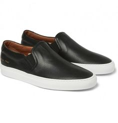 Perforated leather slip-on shoes by Common Projects