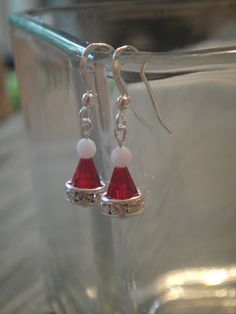 Siam red Swarovski cones-8mm Crystal rondelles-4mm alabaster Swarovski round-6mm crystal AB Swarovski margerite-all metal findings are made with sterling silver-Length of earrings from top of earwire to base of the earring measures approximately 11/2 inches long