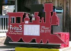 Fritz's Railroad Restaurant - Kansas City, Kansas.  You order your food by phone at the table and it's delivered by a toy train.