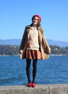 Red beret / leather mini / camel coat / big smile