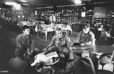 Special Forces Captain Vernon Gillespie Jr. (C) at Boun Bring hall meeting with Montagnard company commanders, trying to talk them out of defecting.