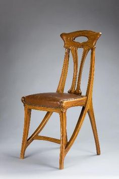 Eugéne Gaillard (1862-1933) - Side Chair. Carved Wood with Leather Seat. Circa 1900.
