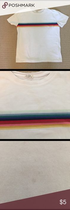 Cute Brandy Melville tee white with rainbow Cute white Brandy Melville. Short sleeve with rainbow stripe on front and back. Very small stain which is shown in picture. I am pretty sure u can bleach the small dot? Not really noticeable. From smoke and pet free home. Brandy Melville Tops Tees - Short Sleeve
