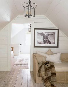 love the floors, walls & ceiling. looks like a perfect attic office.