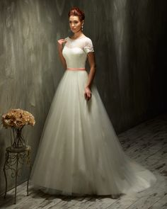 Dress: 70423 Available Colors: Ivory/Coral, Ivory/Ivory, White/Coral, White/White Material: Lace/Tulle  Sizes: EU 32-64 UK 6-38 USA 2-34