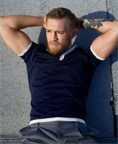 Embracing a fitted look, Conor McGregor sports a Berluti polo with Dolce & Gabbana trousers.