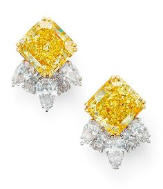 A pair of coloured fancy vivid yellow diamond and diamond ear clips, by Molina.
