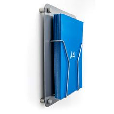 Robust silver aluminium A4 Leaflet Display fixed to the wall with stand off fixings. Our 40mm deep wirework units hold lots of literature.