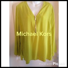"""Of Kors You're Beautiful "" top Delightful citron colored top by MK! Graceful flowy long sleeves and trademark MK zipper up the neck front make this top an eye catcher!! Slits on each side. 27 inches from shoulder to hem. Measures 42 inches around bust.  MICHAEL Michael Kors Tops"