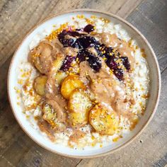 Porridge oats with almond milk topped with a bit of blueberry compote, caramelised bananas and almond butter
