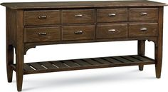 Fulton Market Sideboard  Four drawers offer the look of eight in the Fulton Market Sideboard. Sturdy and functional, with an extra slatted shelf below for additional storage and display, it's the kind of farmhouse chic any foodie who loves to entertain will prize. The Loft finish emphasizes the pronounced grain of the Elm veneer, custom cast hardware completes the look.