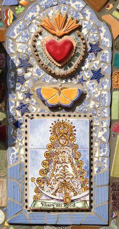 Close up of Spanish Tile Virgin Retablo set into back mosaic wall of studio.