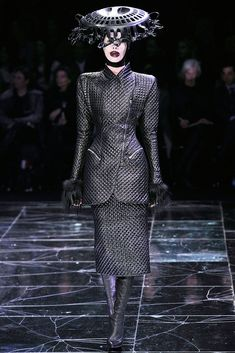 In Alexander McQueen's Fall 2009 Ready-to-Wear line, there is some reference to the 1880's/1890's with the sleeve and structured shoulder of the jacket. It follows the same shape of the leg o'mutton sleeve that was very popular during the 1880's/1890's. Also, the silhouette of the coat looks a bit like a sheath silhouette as it is fitted at the waist and curves around her hips. Although there are a few references to the 1880's/1890's, it gives off a more modern, grunge look with the fabric.