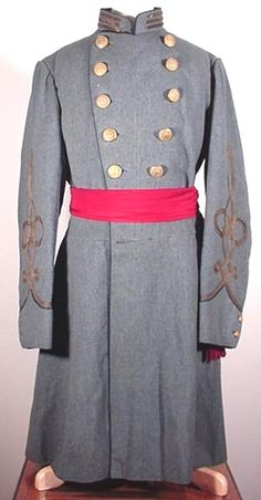 Confederate Officer's Frock Coat worn by Captain Robert Chisolm, Company A, 1st Battalion South Carolina Sharpshooters and later, Company E, 27th South Carolina Infantry. The cuffs, collar, breast and tails are piped in regulation branch of service color infantry blue. The coat is adorned with very rare CS-1 Confederate staff officer's buttons with the Courtney & Tennent backmark. It is one of only a handful of coats in existence with these rare buttons.