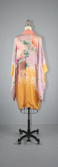Antique 1920s silk flapper kimono. Silk screened with an Asian bird, floral, and cloud design. Ties on the front of the robe. Reversible.  ------------  ❉ Condition: Very good (there is some fading along the top shoulders, as well as a handful of moth holes, such as shown in the last photo; some color transfer on the lining) ❉ Label: -- ❉ Tag Size: -- ❉ Length: about 40 ❉ Bust: 44 ❉ Length (across the sleeves): about 42 ❉ Sleeve length: 24  ------------  ❉ Sizing & Fit - All measurements...