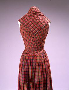 Dress, Evening  Claire McCardell (American, 1905–1958)  Manufacturer: Textile by Galey and Lord, Inc. Date: ca. 1952 Culture: American Medium: cotton Dimensions: Length at CB: 62 1/4 in. (158.1 cm) Credit Line: Gift of Irving Drought Harris, in memory of Claire McCardell Harris, 1958