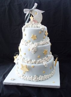 Clouds and stars. (Stars, moon & clouds shower cake by Montreal Confections, http://montrealconfections.com/.)