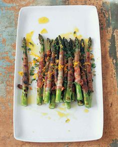 Asparagus Recipes | Martha Stewart Living - To make this vegetable antipasto from Mario Batali, wrap fat asparagus spears in pancetta before searing on the grill. Drizzle them with citronette -- vinaigrette made with orange juice and zest, Dijon mustard, and extra-virgin olive oil -- and sprinkle with fresh thyme before serving.