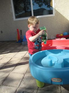 Sensory plastic bottle with rocks, leaves, or other objects that your child places in bottle.