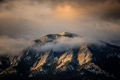 Photo @ladzinski / A quick break in the weather and moment of morning light hitting the snowy #Flatirons before swallowing it up in a bank of clouds. The estimated age of these beautiful formations is roughly 290 million years. The flatiron are famous for rock climbing hiking and trail running and as the backdrop of Boulder Colorado. by natgeo