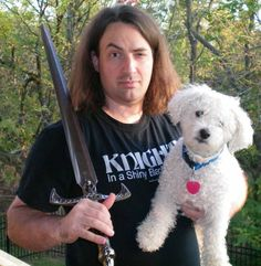 Jim Butcher, author of the Dresden Files! His dog is a Bichon Frise who once saved the family from a bear.
