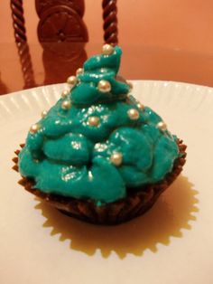 cola flavored cupcake with buttercream icing