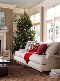 Love the style of this sofa -- from decordove: living room decor for Christmas ~ via Decordove & freshfarmhouse. The Decordove website is online again; check it out !