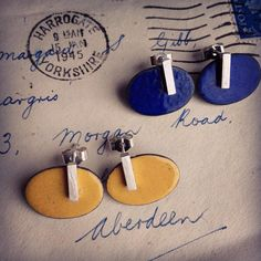 Enamelled Oval Studs with Silver Bar.