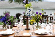 Clusters of flowers as centerpieces.  Chestnut and Vine