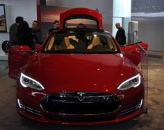 The red Tesla Model S electric luxury sedan showing at the 2013 Detroit Auto Show has a nearly-six-figure sticker price, including the federal tax credit.