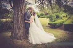 44-wedding-photography-north-devon-bride-groom-look-gardens-tree
