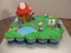 smurf house and toys vanilla and chocolate cupcakes