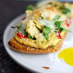 This simple open-faced sandwich features artichokes and red peppers over hummus and bread, drizzled with olive oil. A perfect, easy lunch! | pinchofyum.com