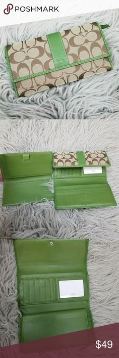 Coach Green Tan Brown Monogram Checkbook Wallet Coach Green Tan Brown Monogram Checkbook Wallet in excellent used condition. Some minor marks from use. Imperfection on removable checkbook holder. Very beautiful!  Please let me know if you have any questions. Happy Poshing! Coach Bags Wallets