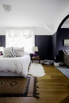 navy blue bedroom with fuchsia lamps and vintage rug | tiffany wendel house tour via coco+kelley