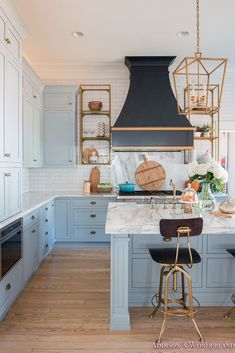 Fresh Ideas for Fall Home Tour! - Addison's Wonderland Inside our vintage modern powder blue gray kitchen cabinets featuring white subway tile, white marble countertops, a custom black vent hood and gold brass fixtures and lighting. Decked out in all of