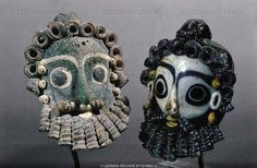 PHOENICIAN JEWELRY 3RD BCE-1ST CE  Two bearded head pendants,protective amulets. Sand-core glass (4th-3rd BCE) from Carthage, Tunisia Height 6 cm  Museum, Carthage, Tunisia