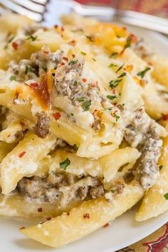 Three Cheese Italian Sausage Alfredo Bake - great make-ahead pasta dish. - Three Cheese Italian Sausage Alfredo Bake – great make-ahead pasta dish. Ground Italian Sausage Recipes, Sausage Recipes For Dinner, Sausage Pasta Recipes, Italian Sausage Pasta, Pork Recipes, Italian Recipes, Cooking Recipes, Italian Sausage Casserole, Recipes With Ricotta Cheese