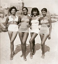 1940s or 1950s, beautiful African-American girls at the beach...this would be during segragation so i'm not sure if this was in the United States or not...no more info was given about the photo :( but good lord, they are gorgeous with their  confident smiles and beautiful retro-pinup style 1940s bathing suits. i love this photo
