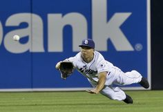 San Diego Padres center fielder Will Venable makes a diving catch to rob New York Mets' Mike Baxter in the ninth inning of a baseball game Friday, Aug. 16, 2013, in San Diego. (AP Photo/Lenny Ignelzi)