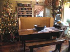 Beautiful Primitive Christmas Tree and Early American Interior ~ Great antique rocking horse under the tree and treenware collection, simple and country.