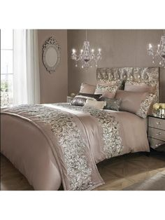 Kylie Minogue Petra Duvet Cover in Double, King and Super King Sizes Flaunting shimmering sheets and sparkling sequins, the Petra range harnesses a little Kylie magic to turn your bedroom into a breathtaking boudoir. Against a sumptuous nude base, sequins in exquisite shades of silver and pewter flow from one side of this duvet cover to the other. This creates a simply stunning effect that makes your bed the centrepiece of the room. Complete the look by matching with the rest of the…