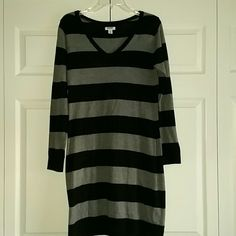 Nwot Old Navy sweater dress Nwot Old Navy sweater dress, size Medium.  Black and gray stripes.  No defects and smoke free home.  I'm about 5'8 and it hits me just above knees.  53% cotton 40%nylon 7% viscose Old Navy Dresses Midi