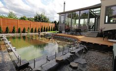 Wrap-Around While the man initially planned on having the porch wrap around and enclose the entire pond, he decided that leaving it open on one end would not only allow easier access to the pool for maintenance, but it would also give the backyard a slightly unique aesthetic appearance (and cut down a bit on …