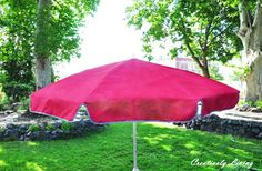 Reviving and Painting Your Old Outdoor Umbrella  ... don't toss it, paint it