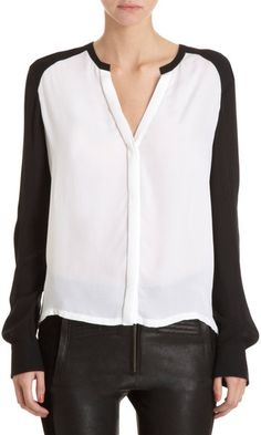 Washed silk double georgette v-neck blouse with hidden button placket, banded collar, and contrast long sleeves.