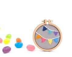 *I would love to buy JUST the mini hoop! Bunting embroidery mini hoop brooch by dandelyne. $40.00, via Etsy.